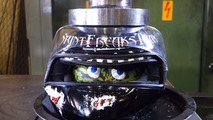 Watch an engine and a helmet get crushed by hydraulic press