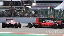 Sebastian Vettel, Ferrari SF16-H spins alongside team mate Kimi Raikkonen, Ferrari SF16-H at the start of the race