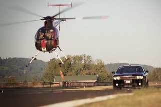 Dodge Challenger SRT8 Takes On An MD500 Helicopter