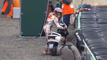 Marc Marquez borrows scooter from camera man after crashing during MotoGP qualifying