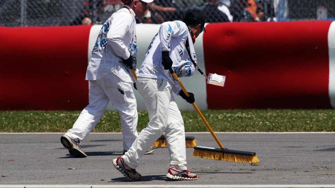 Marshalls sweep debris from the track, Canadian Grand Prix, Montreal / XPB