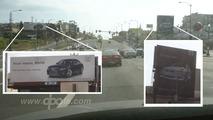 Feuding BMW and Audi billboards on Santa Monica Blvd