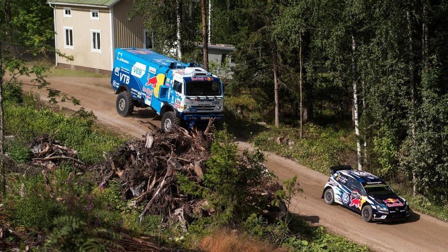Watch a Kamaz Dakar truck catch air chasing down VW WRC car