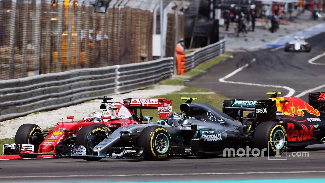 Sebastian Vettel, Ferrari SF16-H, Nico Rosberg, Mercedes AMG F1 W07 Hybrid, and Max Verstappen, Red Bull Racing RB12 collide at the start of the race