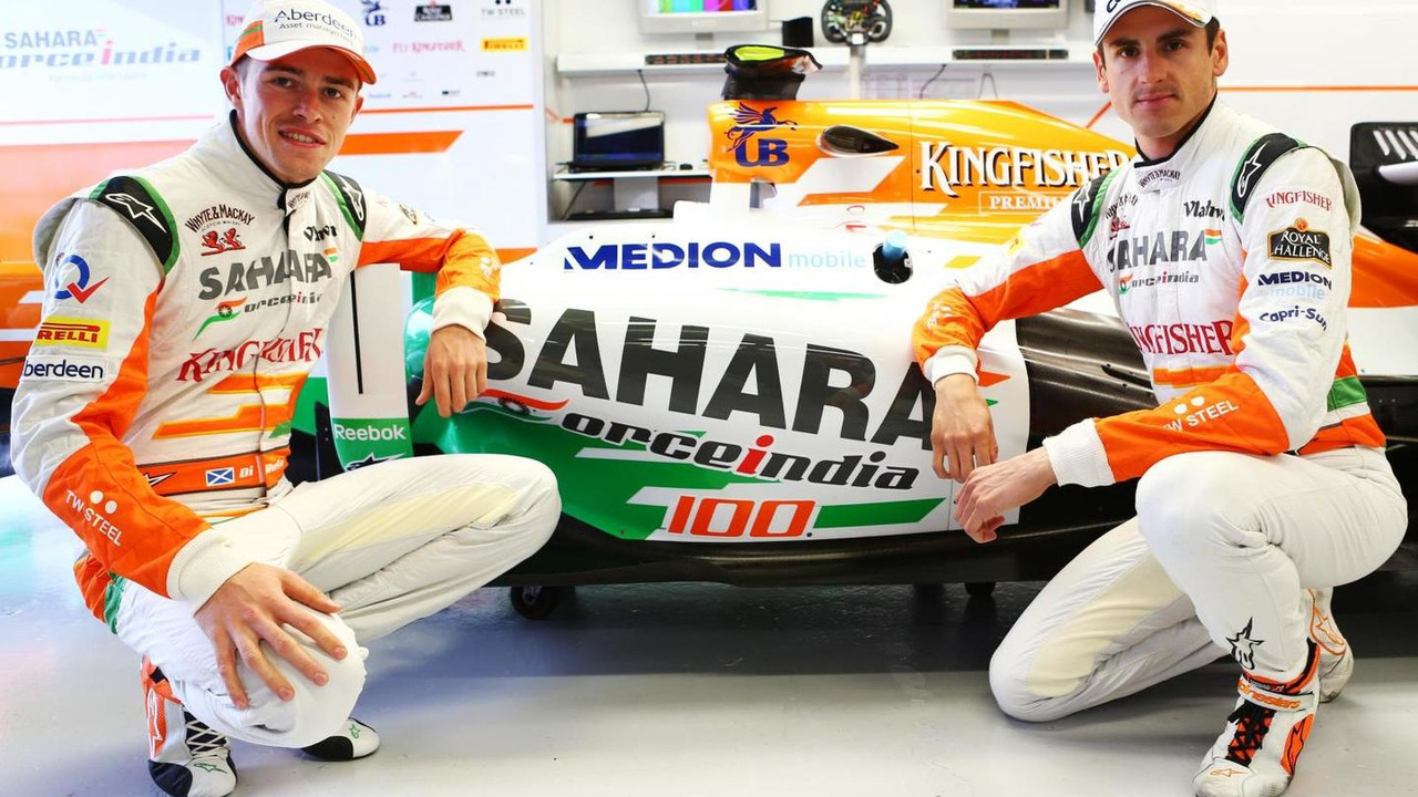Paul di Resta and Adrian Sutil, Sahara Force India F1 celebrate the 100th GP for the Sahara Force India F1 Team