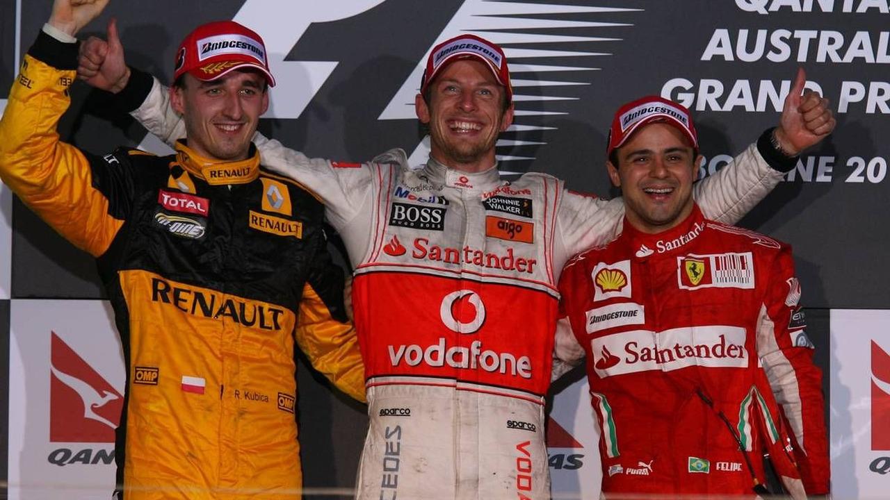 2nd place Robert Kubica (POL) with 1st place Jenson Button (GBR), 3rd place Felipe Massa (BRA), Australian Grand Prix, Podium, 28.03.2010 Melbourne, Australia