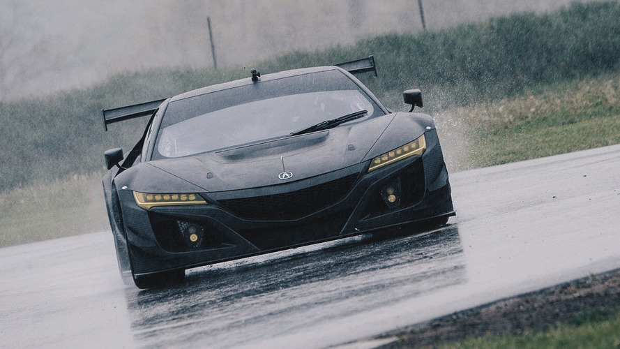 Acura NSX GT3 shows off its carbon fiber body on a wet track