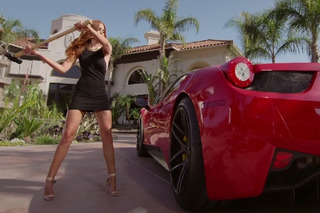 Watch a Supermodel Take a Sledgehammer to a Ferrari 458