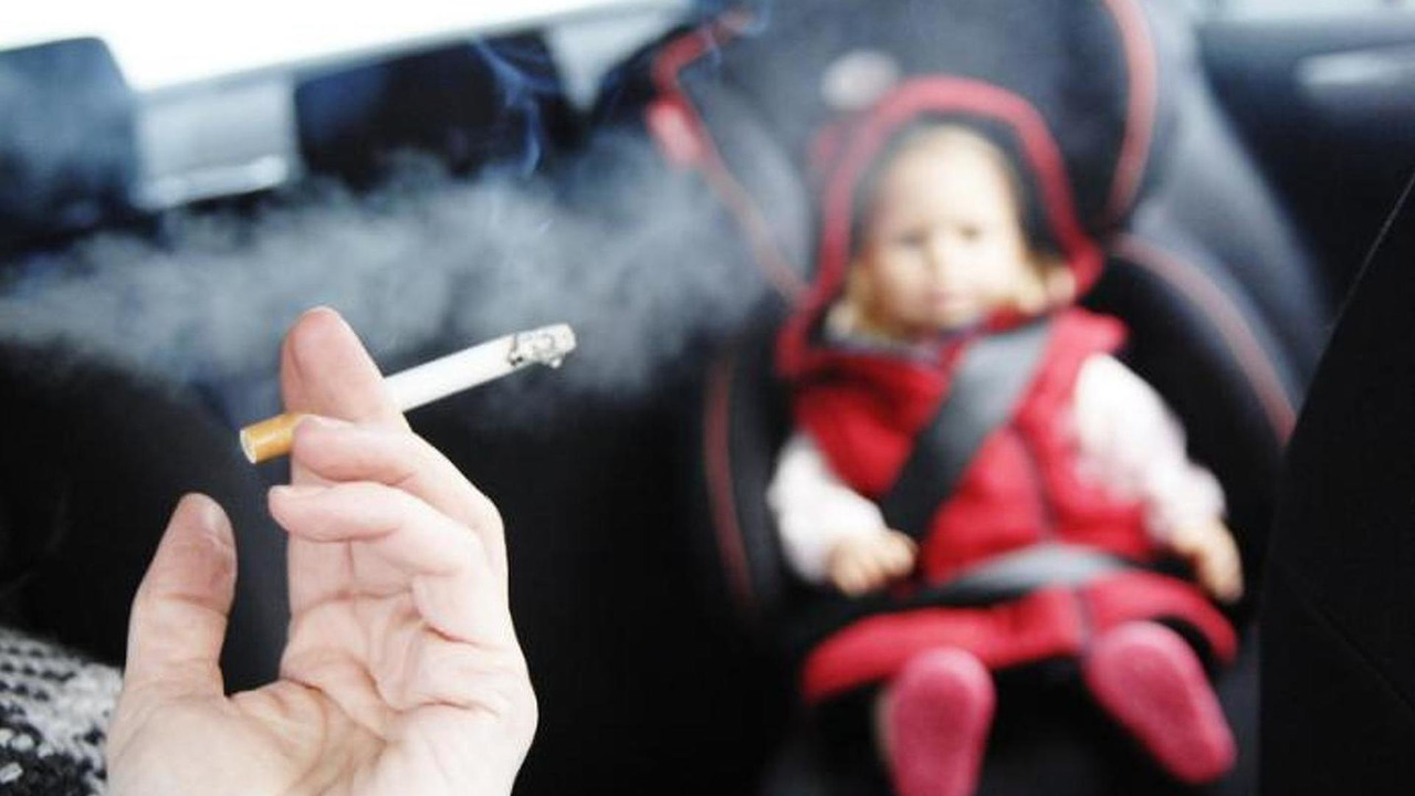 Smoking in car carrying child