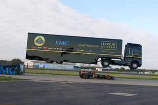 Watch a Tractor Trailer Jump a Lotus F1 Car