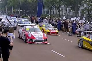 Watch a Porsche 911 Carrera Flash Mob on the Streets of Kuala Lumpur
