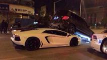 Lamborghini Aventador swoops underneath a Mercedes-Benz GLK