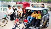 Mini Rick Shaw Taxiing Folks at Beijing Olympics