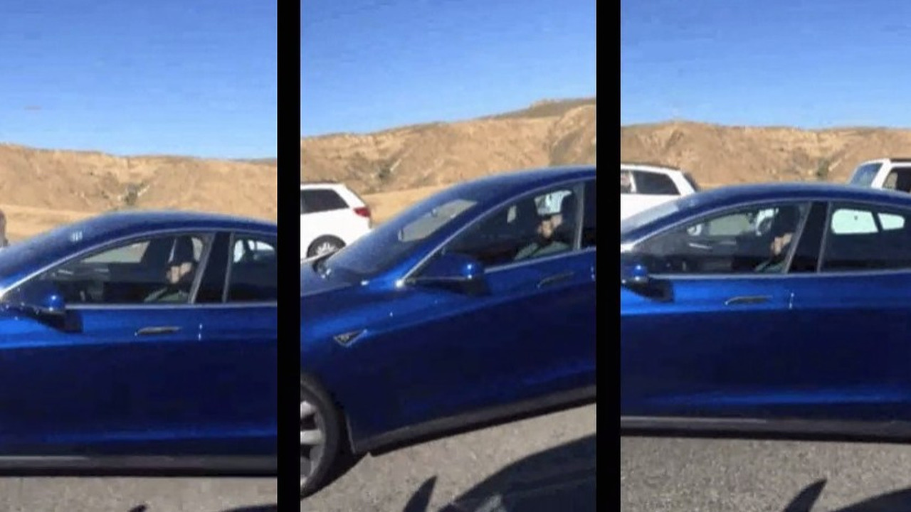 Driver sleeping in Tesla Model S with Autopilot in traffic