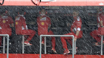 Ferrari pit gantry under heavy rain