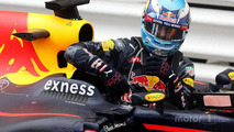 Daniel Ricciardo, Red Bull Racing climbs out of his car in parc ferme