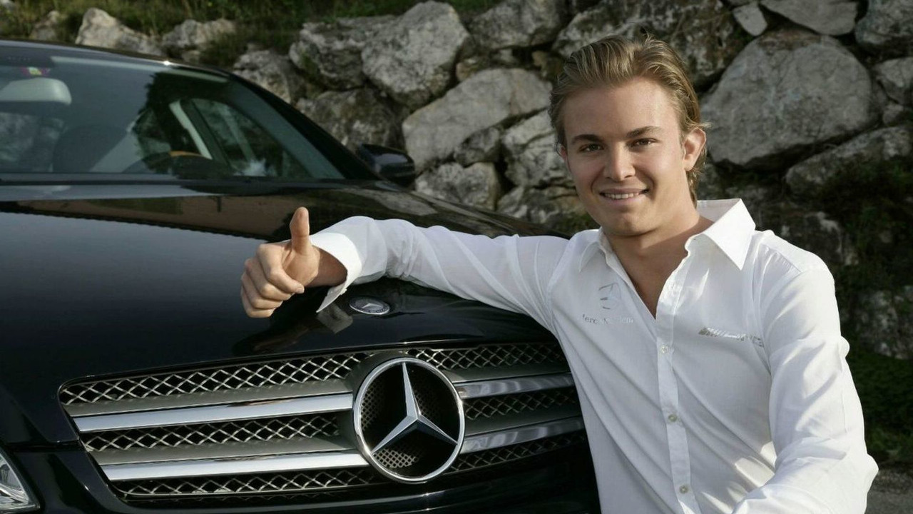 Nico Rosberg poses with Mercedes-Benz car as confirmed driver for Mercedes GP in 2010