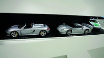 "The exhibition: the Porsche Carrera GT, 2003 (left) and the Porsche 911 GT1 ""Straßenversion"", 1997 (right)"