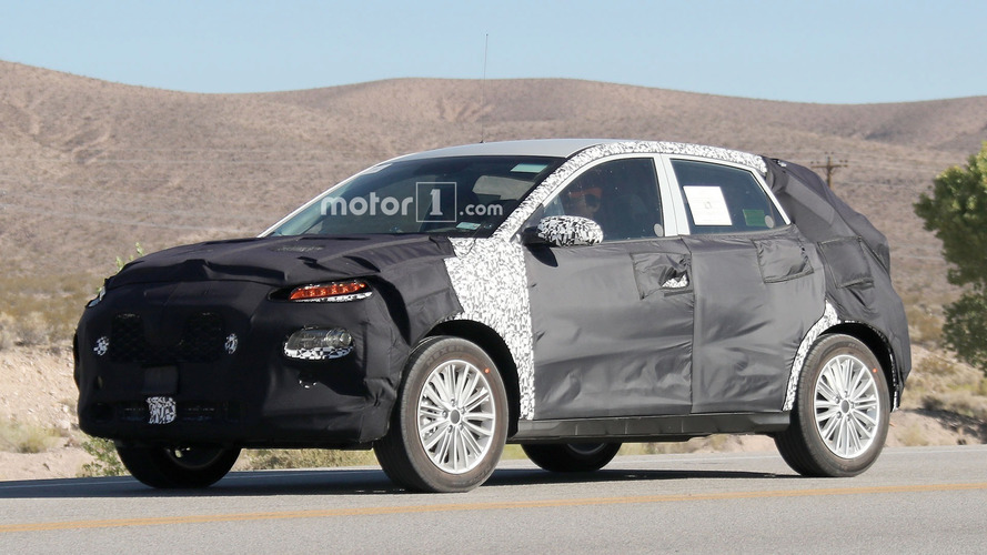 Compact crossover from Kia shows its camouflaged face