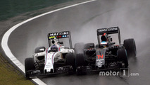 (L to R): Valtteri Bottas, Williams FW38 and Fernando Alonso, McLaren MP4-31 battle for position