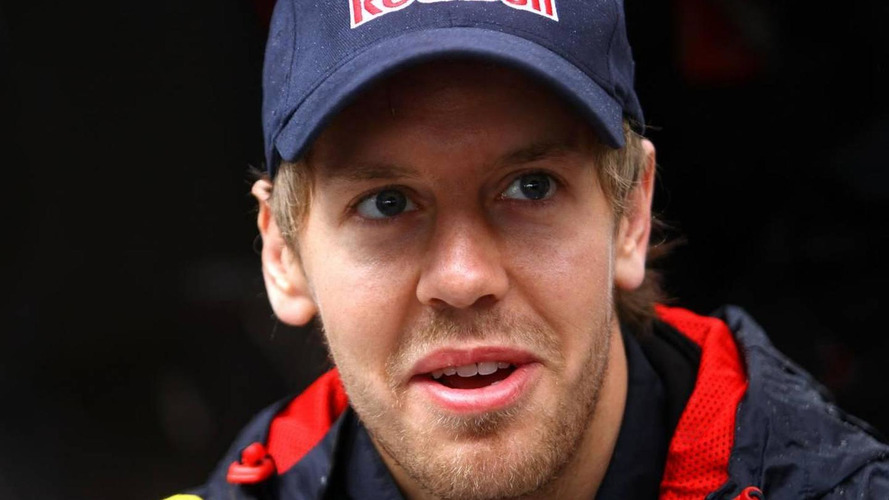 Vettel plays down rumours of 2015 contract talks
