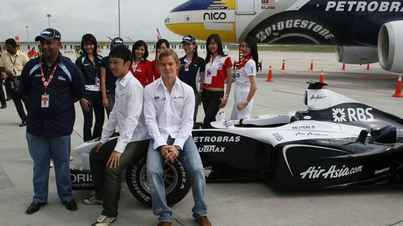 Tony Fernandes, CEO Air Asia, with Kazuki Nakajima (JPN) and Nico Rosberg (GER), Launch of the