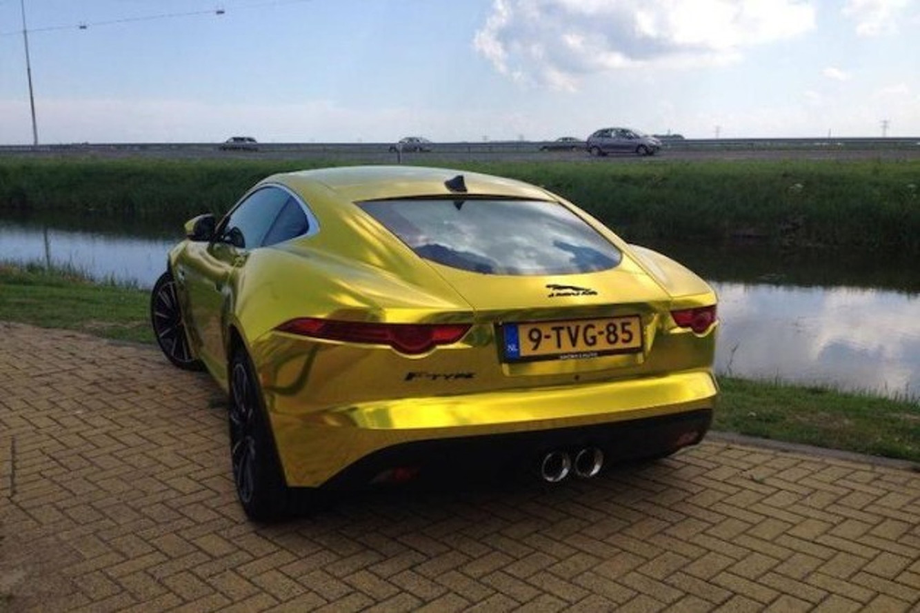 Terrible Gold Chrome Jaguar F-Type Meets Terrible Gold Chrome Land Rover