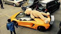 DMC Lamborghini Aventador photographed with a giant teddy bear on the roof in China