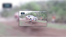 Rally car jumps dog on course
