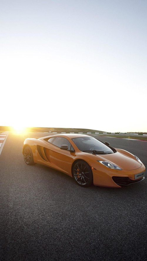 Jay Leno picks up his new McLaren MP4-12C [video]