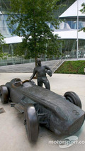 Juan Manuel Fangio bronze statue and his Mercedes-Benz W196, 2009