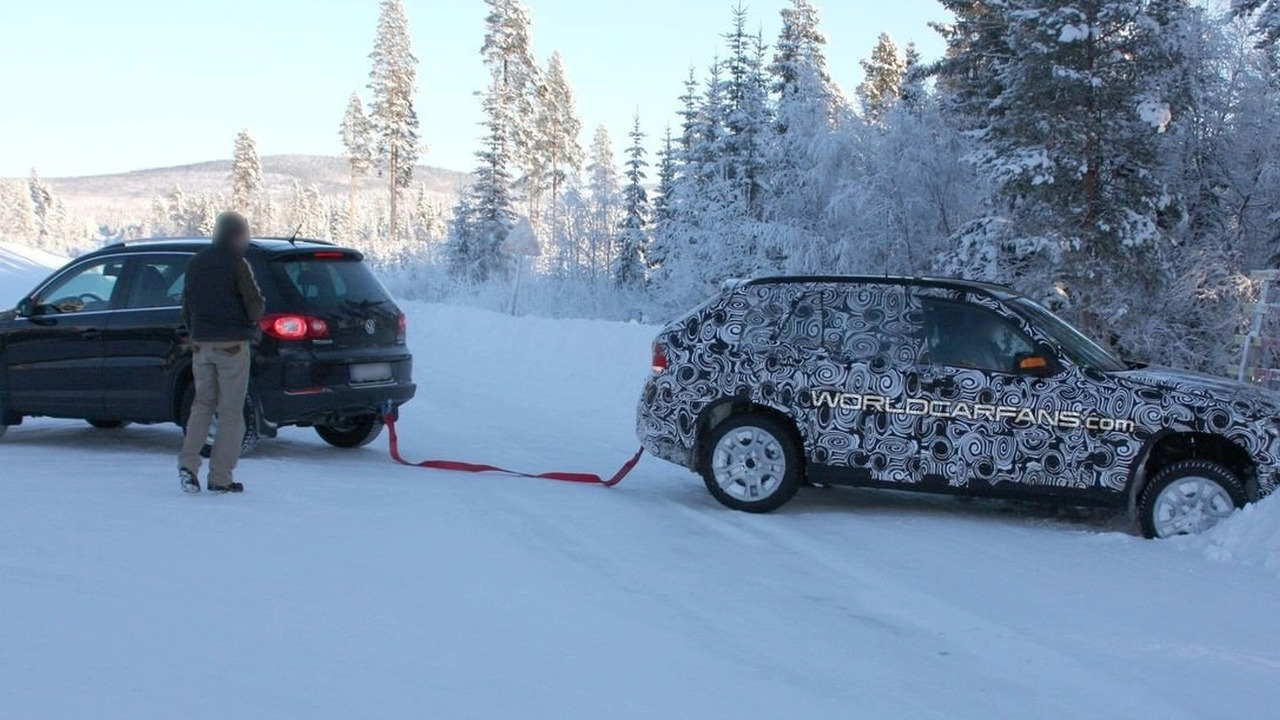 BMW X1 prototype stuck in snow bank
