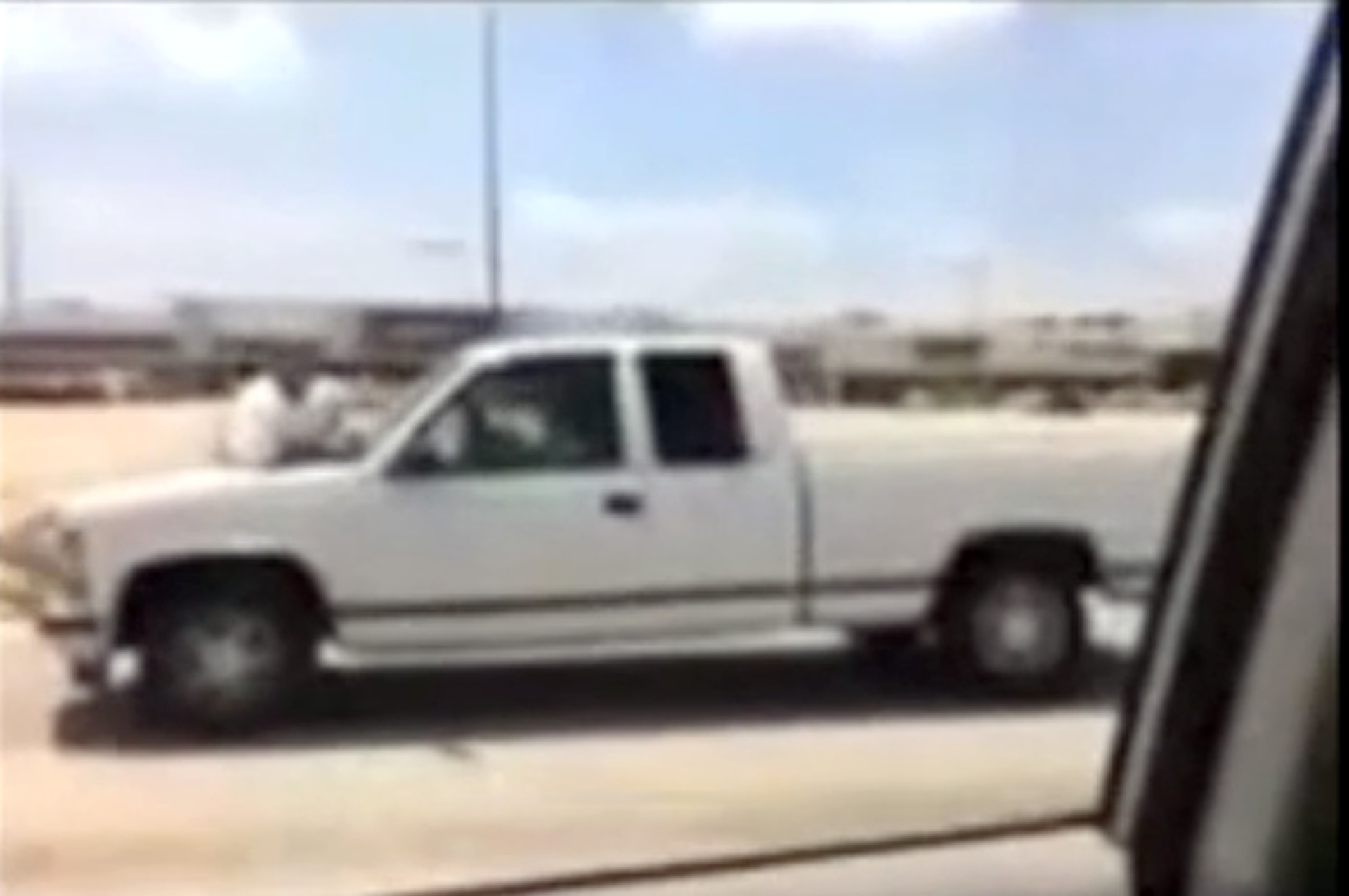 Man Clings to Hood of Pickup Truck [video]