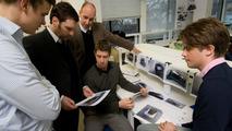 Bentley's Raul Pires, holding design, and Dirk van Braeckel with Bentley finalists David Seesing, Marten Wallgren, Mikka Heikkinen