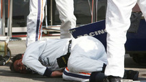 A Trident mechanic is injured before the start of the race, GP2 Championship 2009, Spa Francorchamps, Belgium 29.08.2009