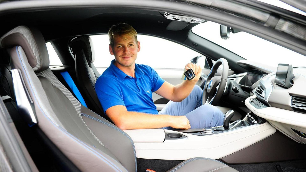 Golfer James Heath and the BMW i8