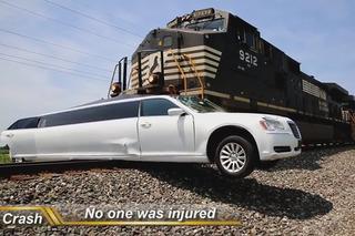 See Train Barrel into Limousine Stuck on the Tracks