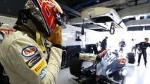 Jenson Button, McLaren puts on his helmet in the garage