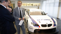 Jeff Koons and Prof. Dr. Mario Theissen, BMW Motorsport Director, study the BMW M3 GT2 in Munich, Germany February 2010 - 07.04.2010