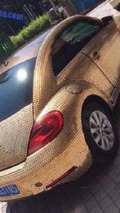 Volkswagen Beetle covered with coins