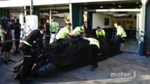 The McLaren MP4-31 of Fernando Alonso, McLaren is recovered back to the pits