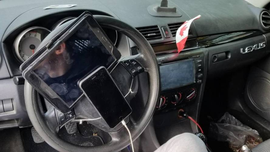 Police Pulls Over Driver With Smartphone, Tablet On Steering Wheel