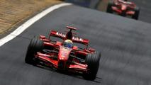 Kimi Raikkonen followed by Felipe Massa