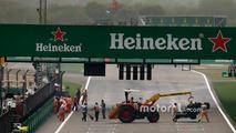 Marshals remove the wrecked car of Antonio Giovinazzi, Sauber C36