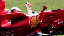 World Champion Kimi Raikkonen, Ferrari F2007 celebrates victory