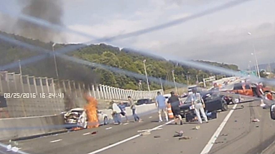 Woman saved from burning car by fellow motorists