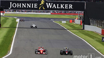 Sebastian Vettel, Ferrari SF16-H and Jenson Button, McLaren MP4-31 battle for position
