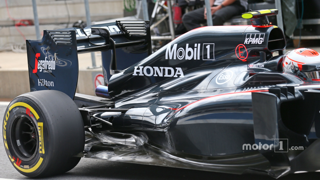 Jenson Button, McLaren MP4-30 engine cover and rear suspension detail