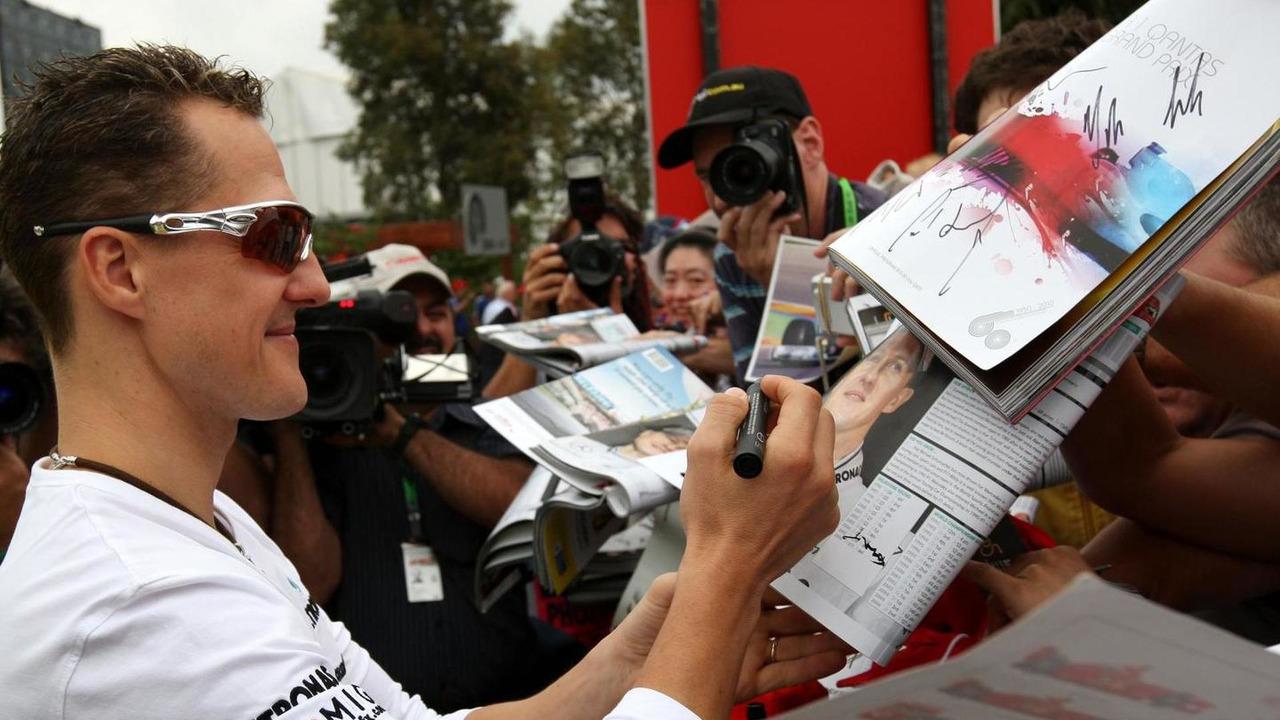 Michael Schumacher signing autographs 28.03.2010 Australian Grand Prix