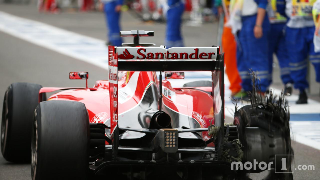 Sebastian Vettel, Ferrari with his punctured Pirelli tyre